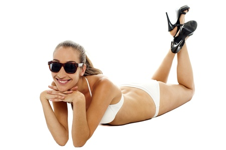 Attractive young model wearing bikini and goggles. White background. Stock Photo - 16469285