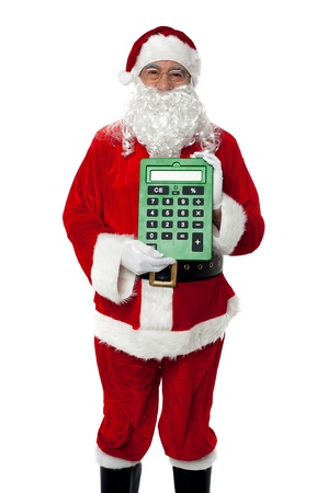 Old man dressed as Santa showing a large green calculator to the camera Stock Photo - 16510498