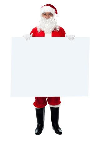 nicholas: Full length portrait of Saint Nicholas standing behind blank whiteboard. Stock Photo