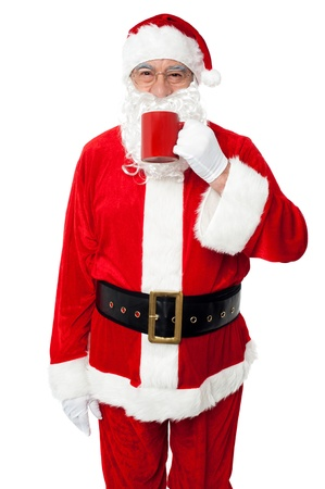 Aged smiling Santa enjoying his coffee isolated over white background. Stock Photo - 16510737