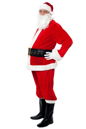 Confident Santa with a big belly posing sideways isolated over white. Stock Photo - 16510319