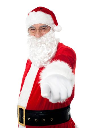 Elderly cheerful Santa pointing at you. Christmas holiday concept. Stock Photo - 16510572