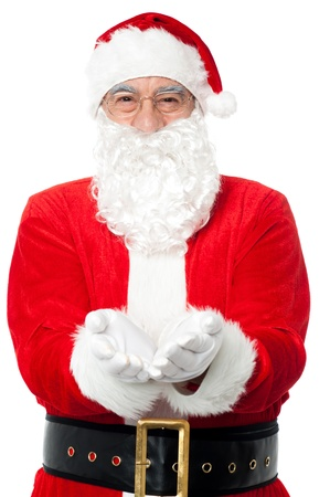 kris kringle: Bespectacled Father Santa posing with open palms. Christmas concept