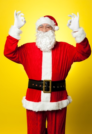 Aged Santa gesturing perfect sign with both hands. Indoor shot Stock Photo - 16510854