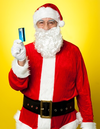 Male in Santa costume posing with his cash card. Lets go shopping. photo