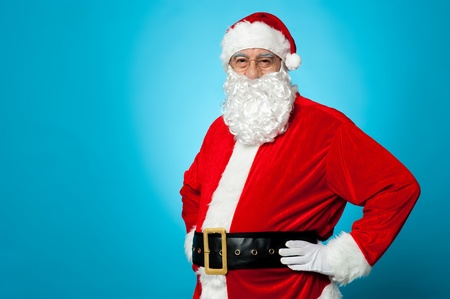 Aged Santa posing with hands on his waist. Half length portrait Stock Photo - 16510604
