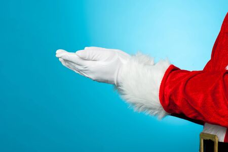 Cropped image of Santa with open palms. Gradient blue background. Stock Photo - 16510365