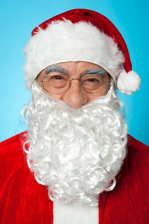 Snapshot of smiling senior man in Santa attire. Isolated on blue background. Stock Photo - 16511177