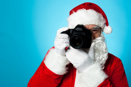 photographers: Say Cheese! Santa - The Professional Photographer. Stock Photo