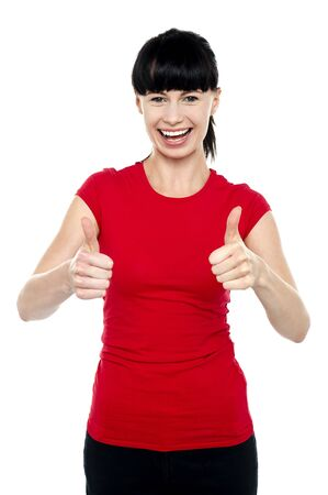 Happy woman gesturing double thumbs up sign isolated on white background. Stock Photo - 16511766