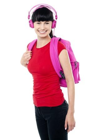 casuals: College teen dressed in casuals enjoying music through headphones.