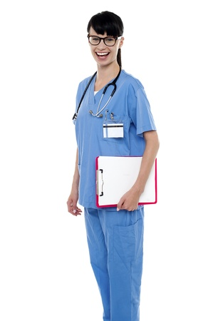 Duty doctor posing with case sheet in hand. Studio shot. photo