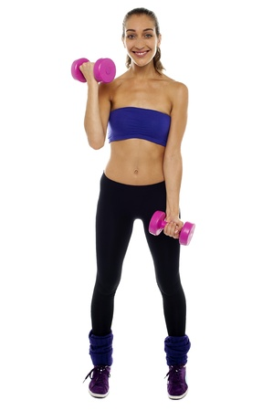 Woman working out to stay slim, fit and healthy. Looking and smiling at camera. Stock Photo - 16511306