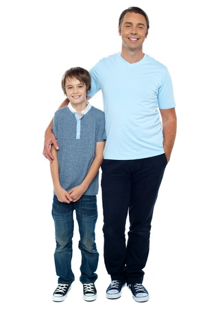 father and son: Casual studio shot of father and son. Full length portrait.