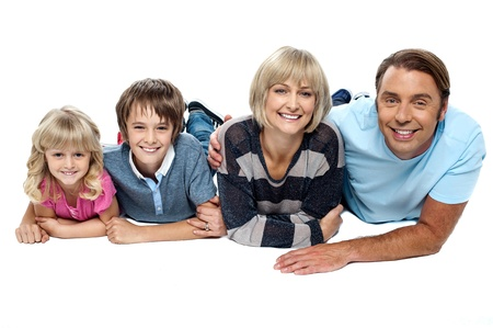 Smiling family of four relaxing on white background. Display of love and affection. Stock Photo - 16634386
