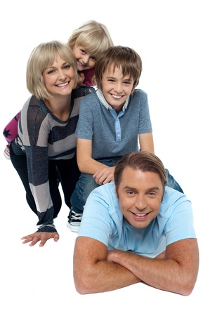 exhibiting: Fun loving family exhibiting great bonding. Indoor studio shot. Stock Photo