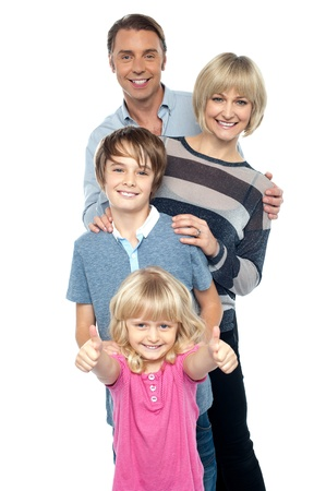 posing  agree: Group portrait of a playful family of four. Smiling heartily Stock Photo
