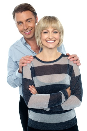 fashionable couple: Lovely young couple portrait against white background. Love and affection. Stock Photo