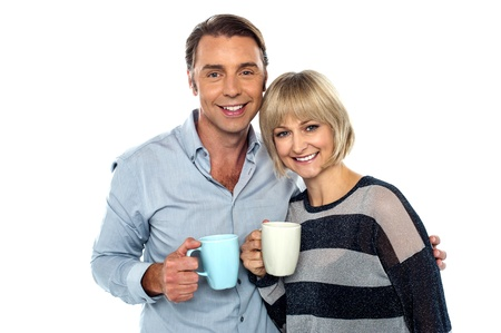 cherishing: Couple starting their day with a cup of coffee. Cherishing it together.