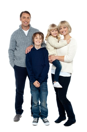 family relationships: Full length portrait of a happy family posing in trendy winter wear outfits. Stock Photo
