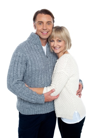 Fashionable woman hugging her loving husband. Middle aged love couple. photo