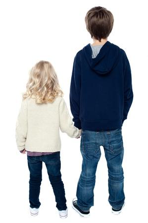 kid friendly: Rear view of two little kids looking in opposite direction.