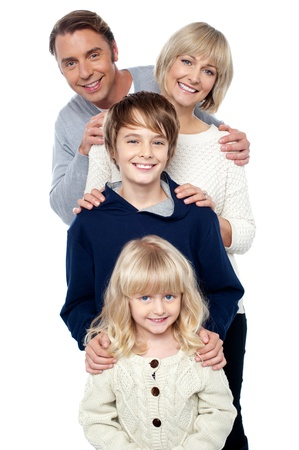 Complete family. Daughter, son, mother and father. Standing behind one another. Stock Photo - 16634429