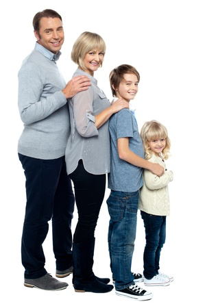 Full length family portrait of four members. Standing in a line formation. Stock Photo - 16634452