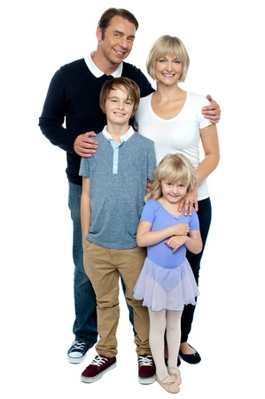 Indoor studio shot of lovely family, four members. Photogenic family photo