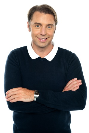 Handsome middle aged male model posing with confidence, arms folded. Stock Photo - 16634424