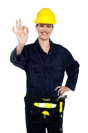 Woman construction worker at her best gesturing perfect sign to the camera. Stock Photo - 16686837