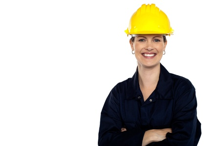 Beaming construction worker wearing yellow safety helmet. Cheerful portrait photo