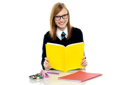 assessments: Studious student wearing spectacles preparing for her upcoming assessments Stock Photo