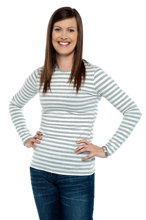 Trendy woman posing with hands on her waist. Studio shot Stock Photo