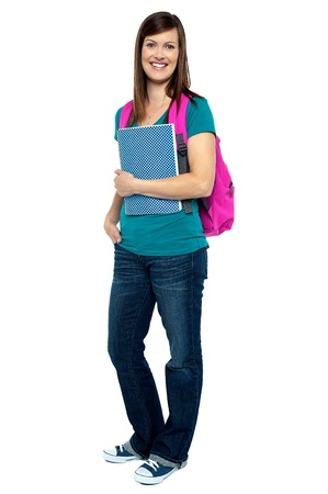 college girl: Full length portrait of pretty college girl carrying pink backpack. Casual studio shot.