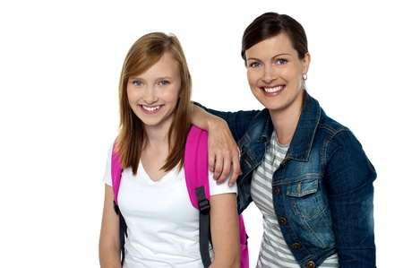 casuals: Senior and junior college colleagues. Lady dressed in fashion wear whereas girl in casuals carrying backpack. Stock Photo