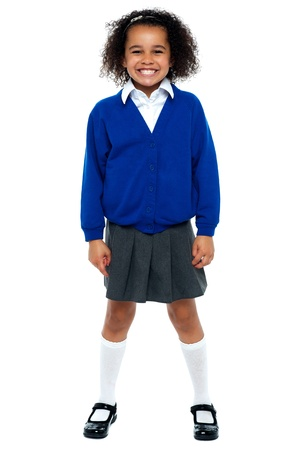 Full length portrait of a joyous African school girl. All against white background. Stock Photo - 16771507