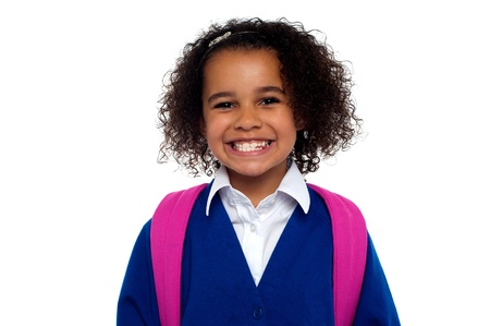 Happy school going girl. Beautiful African student in uniform with backpack smiling at you. Stock Photo - 16771539