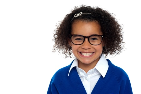 grinding teeth: African origin bespectacled primary girl on a white background.