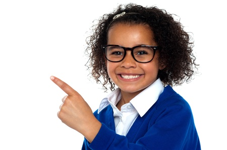African primary girl showing the way to her classroom. Isolated against white. Stock Photo - 16771529