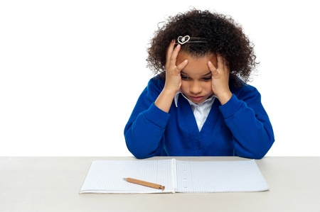Stressed out primary girl child thinking hard to recollect the answer