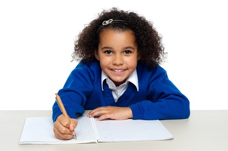 Young girl writing copying notes from the whiteboard. Isolated against white background. Stock Photo - 16771541