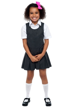 Cheerful young kid in pinafore dress posing smilingly isolated on white background. Stock Photo - 16771506
