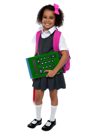 Pretty doll is ready for school. Smilingly facing camera. Stock Photo - 16771504