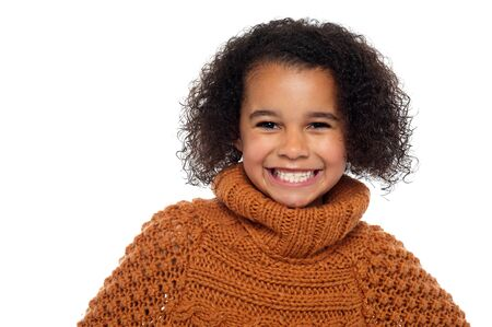 Snap shot of a stylish african girl in winter clothes flashing a warm smile. Stock Photo - 16771550