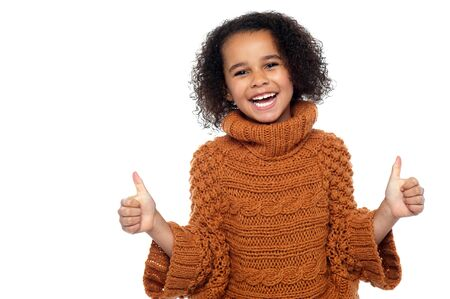 Pretty kid laughing and showing double thumbs up gesture to camera. Stock Photo - 16771545