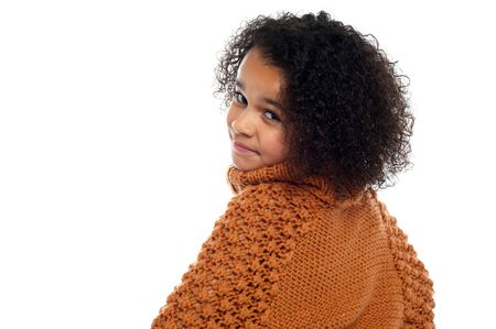 over sized: Little girl with over sized sweater on turning back and looking at you.
