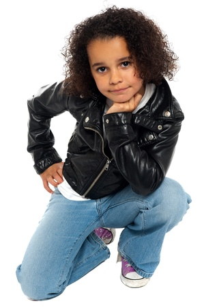 Afro American kid posing stylishly to the camera. All on white background. photo