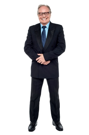 Full length portrait of a senior businessman smiling at the camera. Stock Photo - 17044191