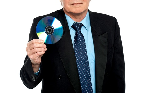 Cropped image of a male showing compact disk to the camera. Blank DVD photo